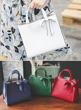鲜艳颜色蝴蝶结装饰手提包